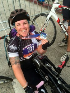 Loma Linda University Health PossAbilities member Jenna Rollman, 28, shows off her first place medal after competing in the 2015 Asics LA Marathon hand cycling race onSunday, March 15.
