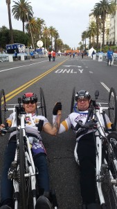 Owen Daniels, left, was all smiles after winning the men's handcylcing competition of the Asics LA Marathon on March 15, 2015. Michael Reardon, right, came in second place.