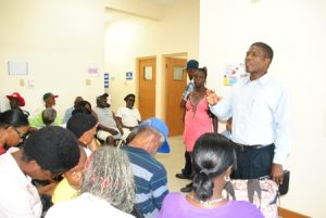Pastor_Archer_praying_for_the_community_members_at_the_Exchange_health_fair._large