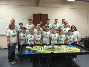 Lego® Robotics class members pose together during preparation for the showcase