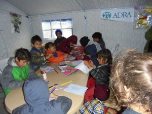 Children participate in ADRA's informal education program by drawing pictures at Baharka IDP Camp. Credit: ADRA International