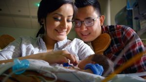 """In the first episode of """"Life on the Line,"""" Janett Anguiano and Gian Ledesma hold their baby, Theodore, for the first time 10 days after he was born."""
