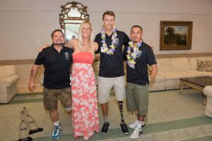 Bethany Hamilton stuck around the PossAbilities Sports Luncheon to meet with fans and athletes, including PossAbilities members Greg Crouse (left), Andre Barbieri (center) and Zimri Solis.