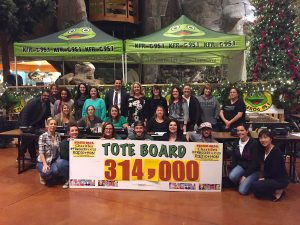 Event volunteers as well as representatives form K-FROG and Stater Bros. Charities proudly display the final total of funds raised for LLUCH during the 14th annual Stater Bros. Charities K-Froggers for Kids Radiothon, Dec. 2