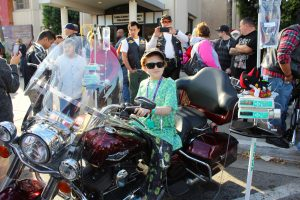 LLUCH patient, Zander Moncada, 11, from San Jacinto, climbed aboard one of the participating motorcycles of the 23rd annual Toy Run presented by Quaid Harley-Davidson on Sunday, Dec. 13.