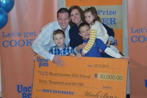 The Fulmer family celebrates the school winning $30,000 from Uncle Ben's. Credit: ANN/Tamyra Horst, courtesy of the Pennsylvania Conference of Seventh-day Adventists.