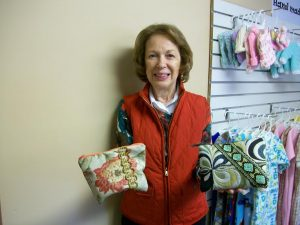A volunteer for Richland Crisis Pregnancy holds some of our zippered pouches that are so popular with the young mothers.