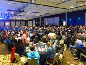 This is what 1200-plus people look like attending The One Project in the Grand Ballroom at Seattle's Westin Hotel. Attendees sat at 10-chair tables, provided with pens, schedules and questions to discuss after the presentations were made.