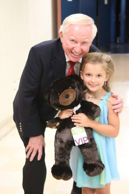 Heritage Singers' Max Mace gives a bear to Brilee Grace. Photo by C. Derry-Bretsch